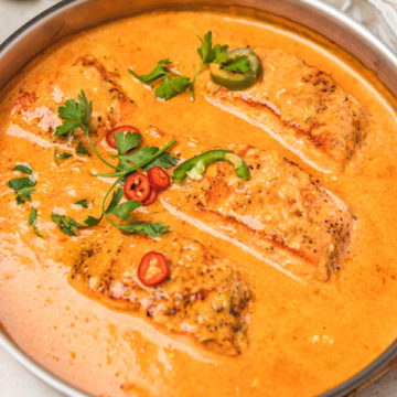 an overhead shot of salmon curry in a pan.