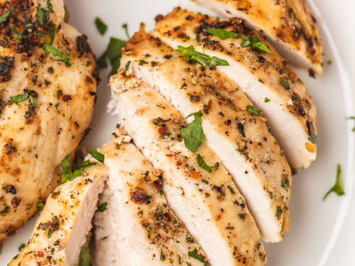 slices of chicken breast on a white plate.