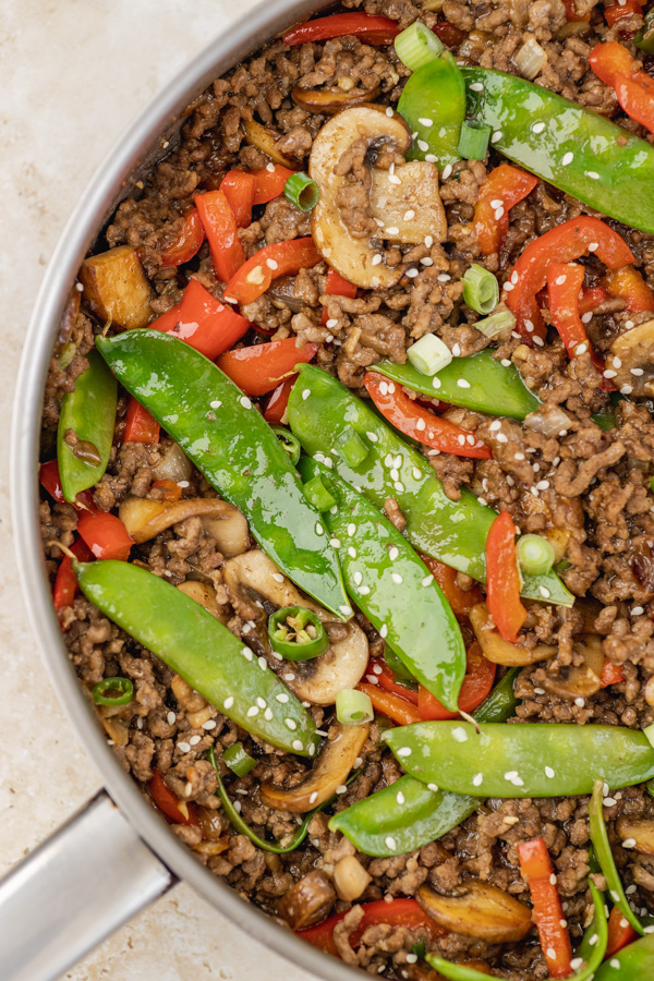 freshly cooked veggie and ground beef stir fry in a skillet.