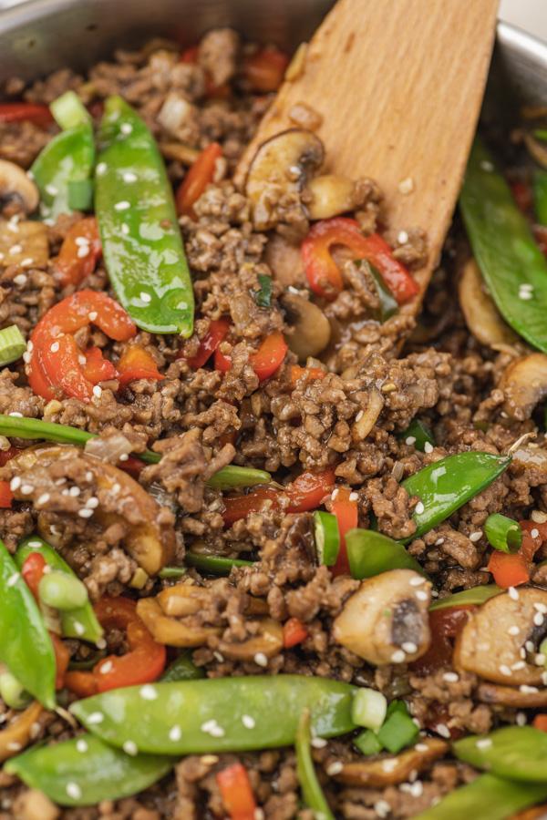 a close shot of beef stir fry with veggies.