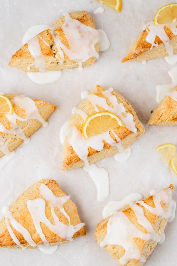 the overhead shot of glazed triangular lemon scones.