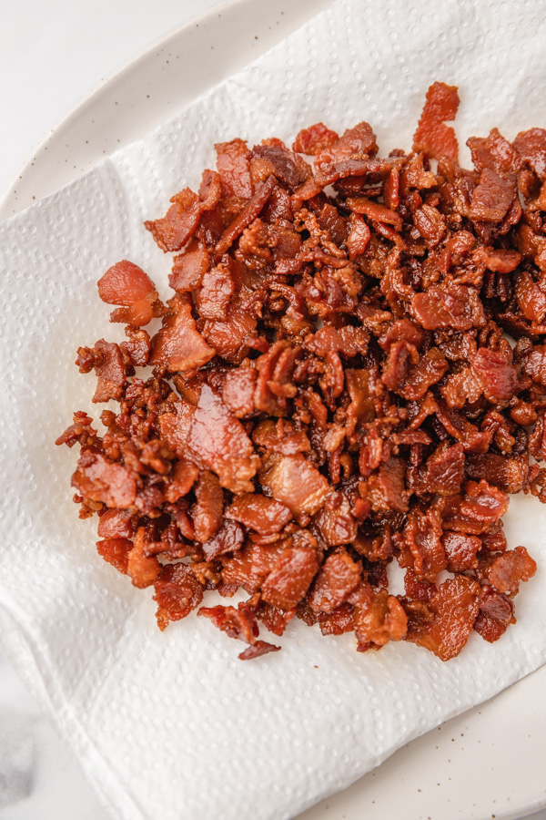 bacon bits on a lined kitchen towel plate.