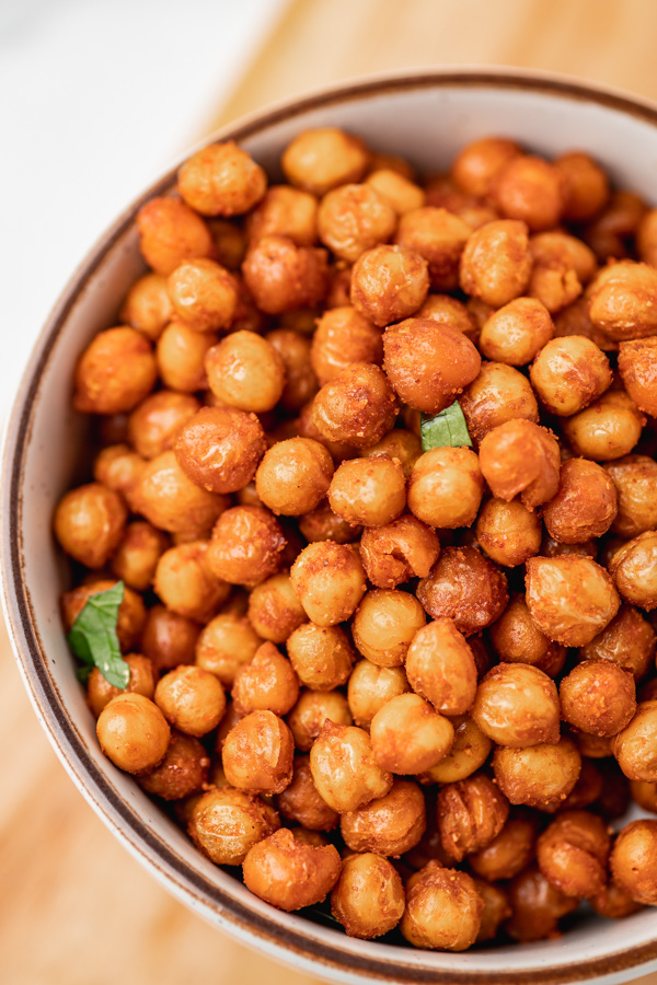 a close up on a bowl of roasted chickpeas.
