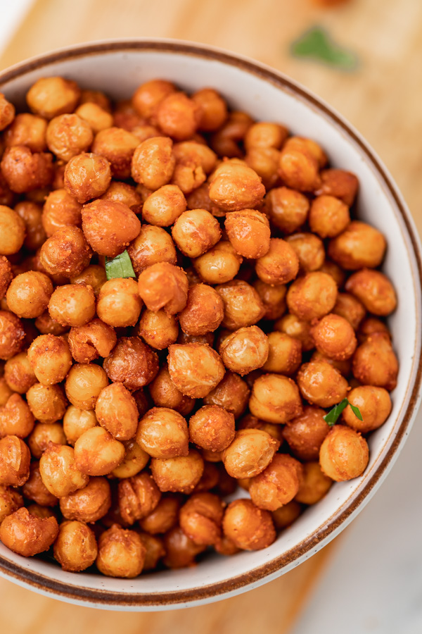 a close up on chickpeas in a small serbing bowl.